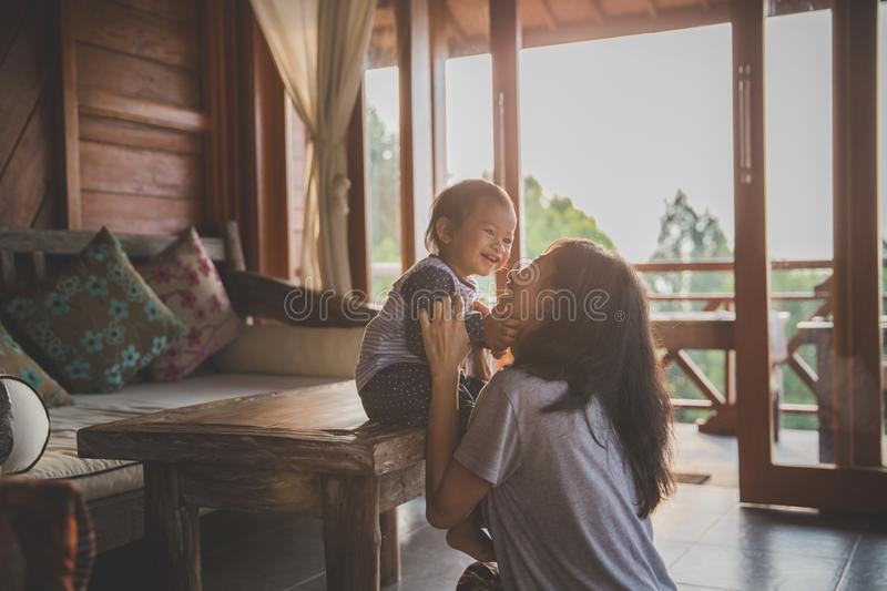 Mother and child girl playing. Happy loving family. mother and child girl playing, kissing and hugging stock photo