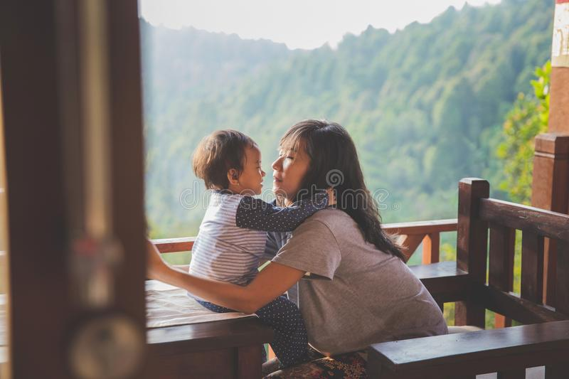 Mother and child girl playing. Happy loving family. mother and child girl playing, kissing and hugging royalty free stock photos