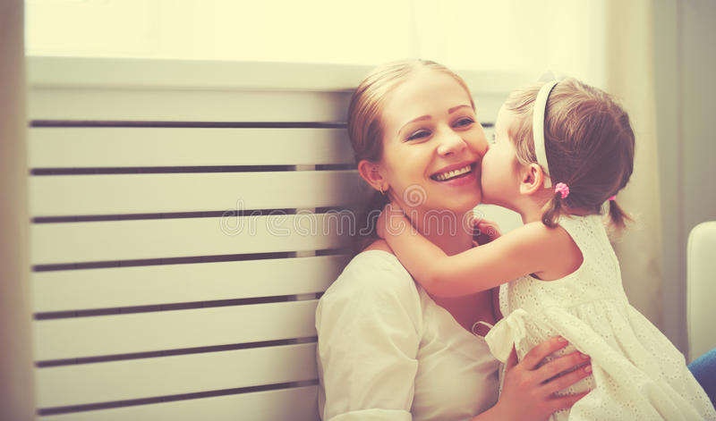 Happy loving family. mother and child playing, kissing and hugg stock photo