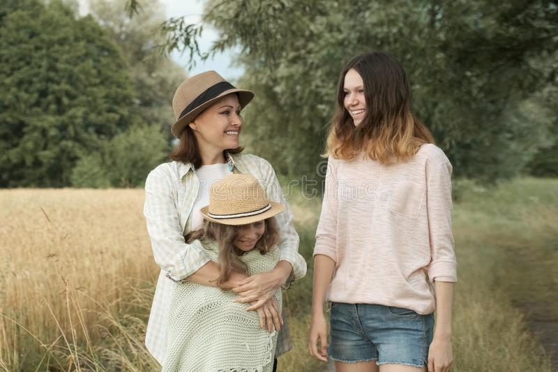 Happy loving family mother and children two daughters walking together stock photos