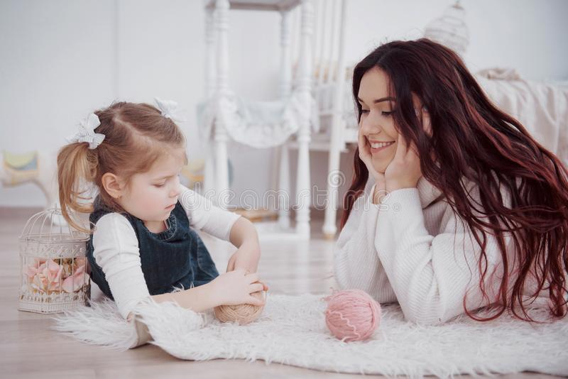 Happy loving family. Mother and her daughter child girl playing stock photos