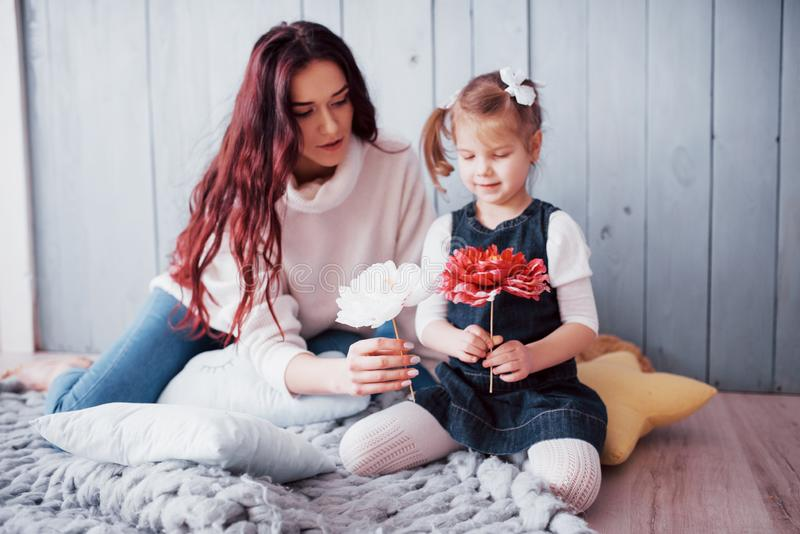 Happy loving family. Mother and her daughter child girl playing stock image