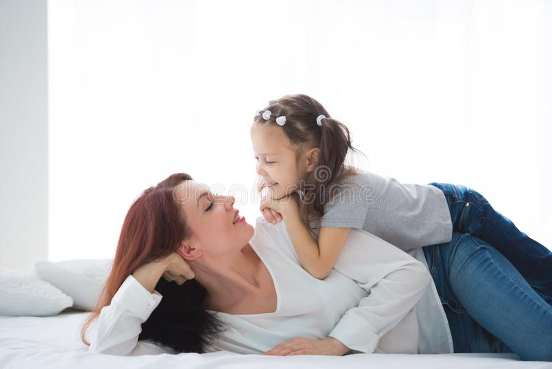 Happy loving family. Mother and her daughter child girl playing and hugging royalty free stock photos
