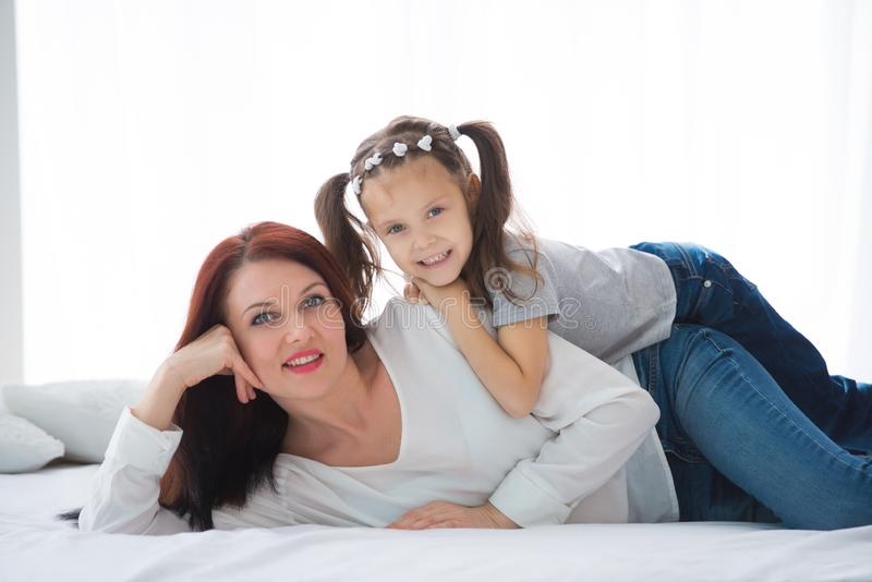 Happy loving family. Mother and her daughter child girl playing and hugging royalty free stock image