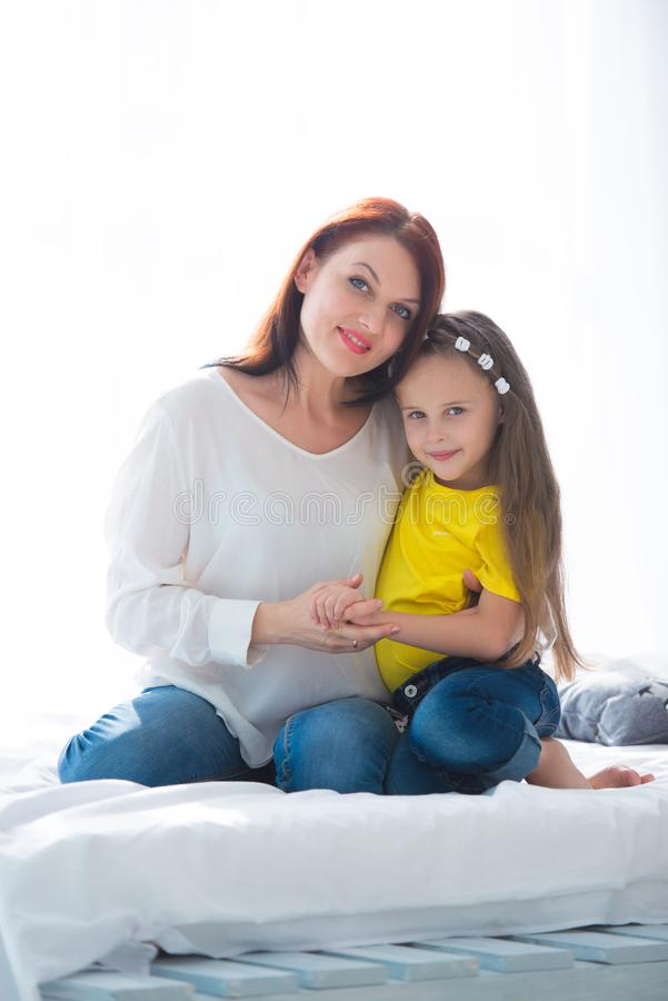 Happy loving family. Mother and her daughter child girl playing and hugging stock photos