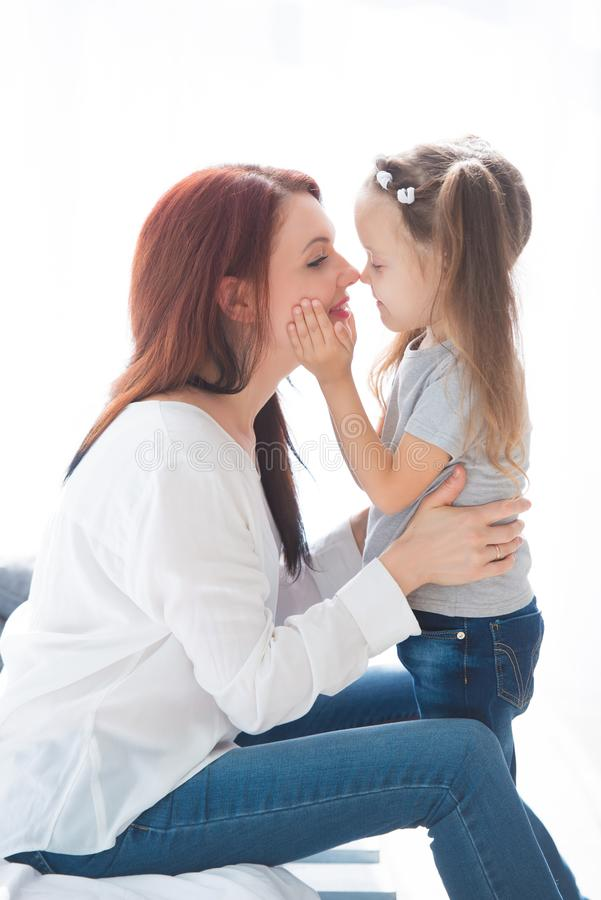 Happy loving family. Mother and her daughter child girl playing and hugging stock photo