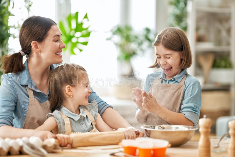 Family are preparing bakery together royalty free stock image