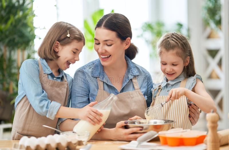 Family are preparing bakery together stock photography