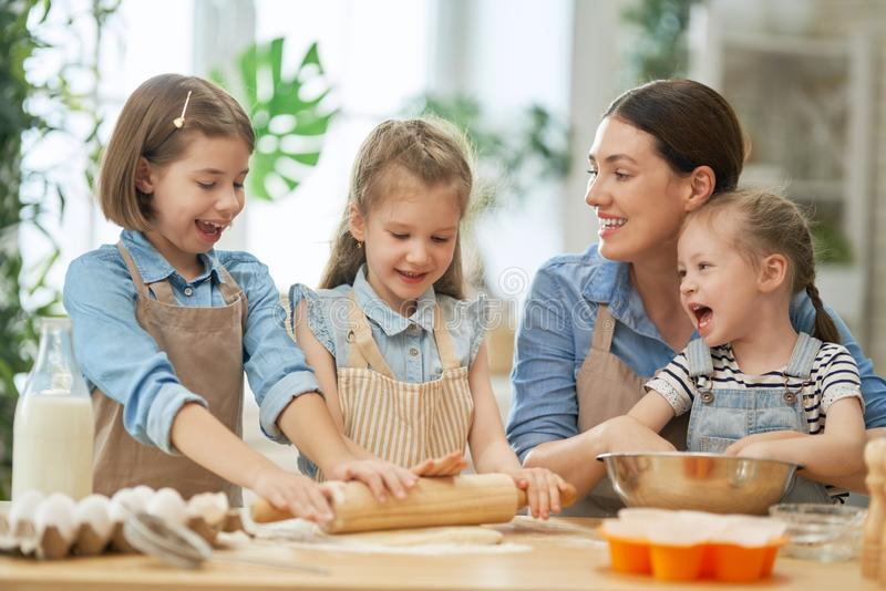 Family are preparing bakery together royalty free stock photos