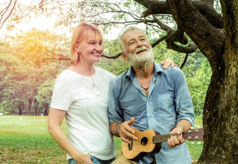 Happy loving senior couple spending the day in the countryside and having fun. concept about seniority and people stock photography