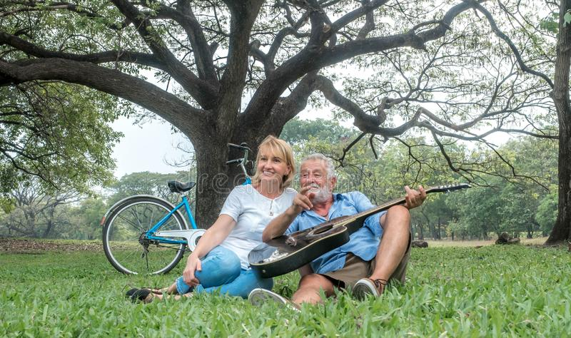 Happy loving senior couple spending the day in the countryside and having fun. concept about seniority and people stock photos