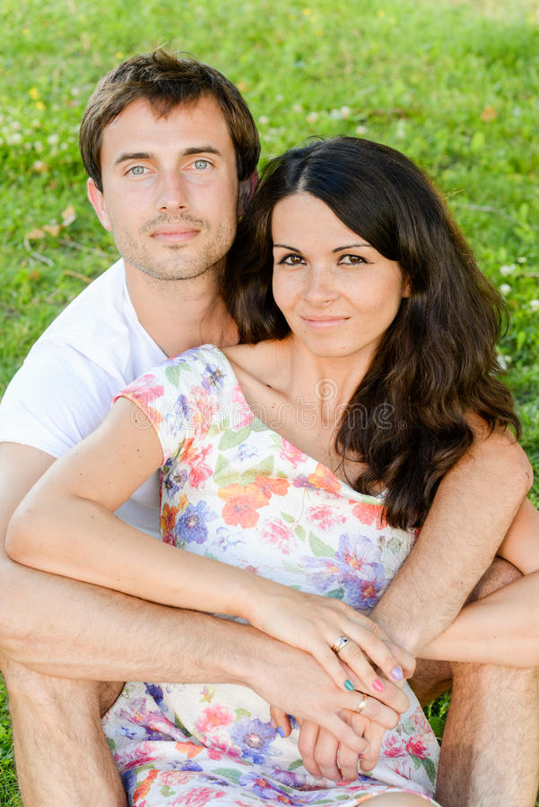 Happy loving smiling young couple outdoors royalty free stock photo