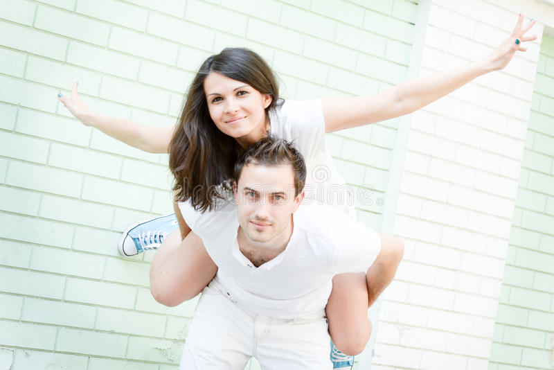 Happy loving young couple outdoors stock image