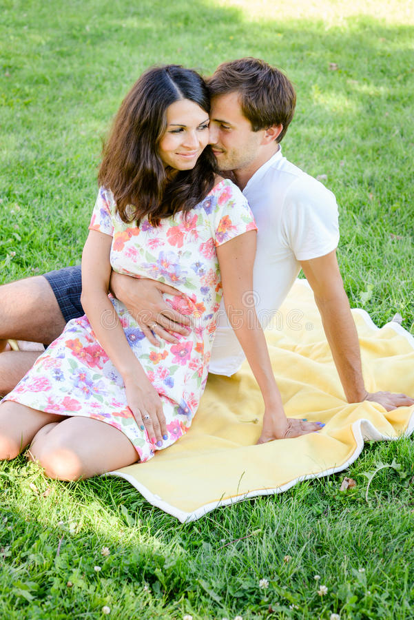 Happy loving young couple outdoors royalty free stock photos