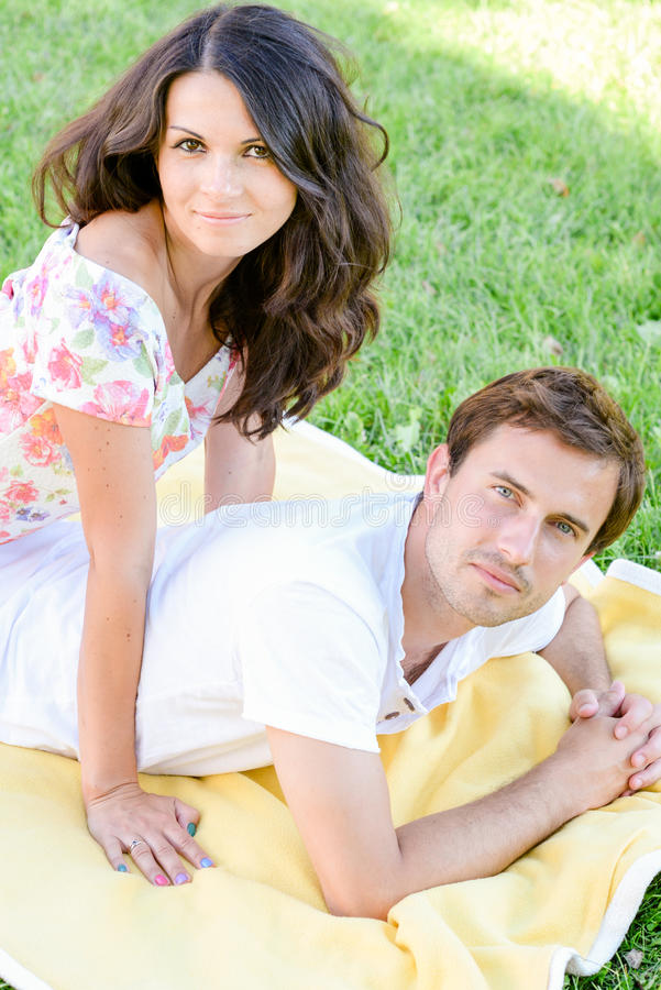 Happy loving young couple outdoors royalty free stock photography