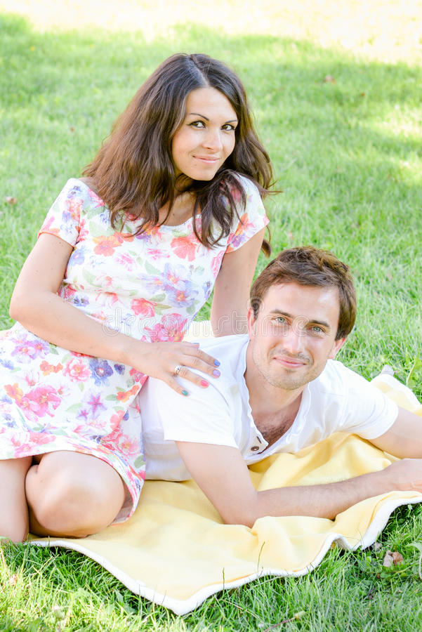 Happy loving young couple outdoors stock photography