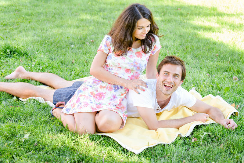 Happy loving young couple outdoors stock photo