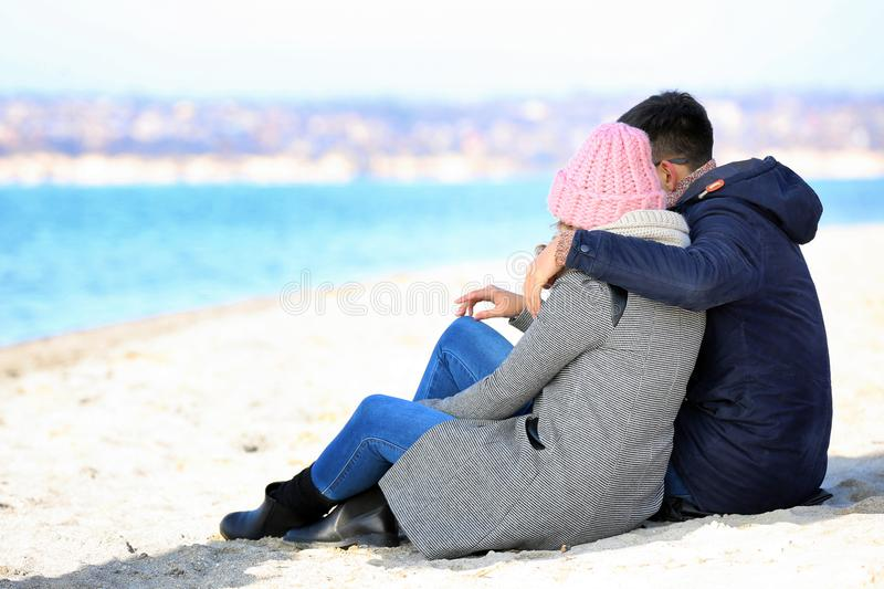 Happy loving young couple sitting stock photo