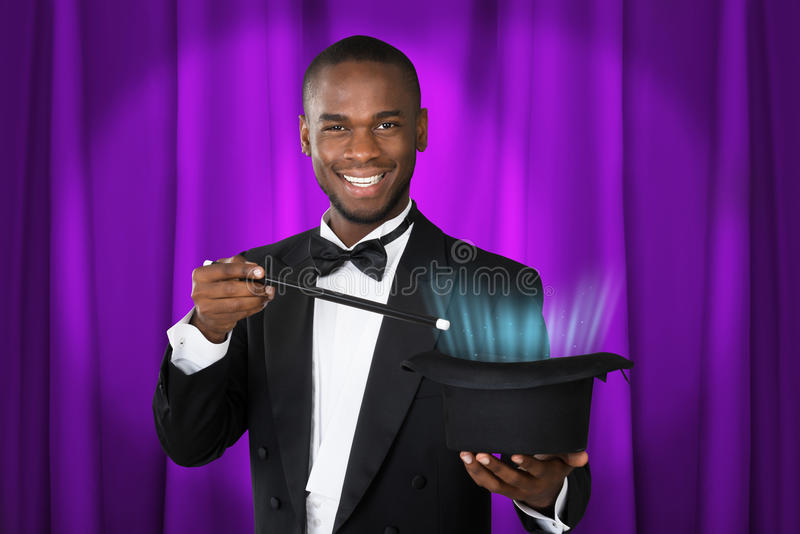 Happy Magician Showing Magic stock image