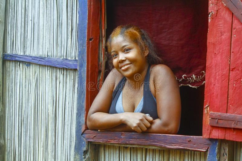 Happy malagasy woman in her traditional house stock image