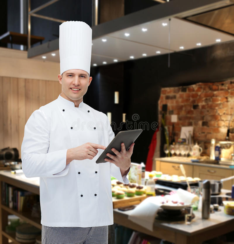 Happy Male Chef Cook Holding Tablet Pc Stock Photo