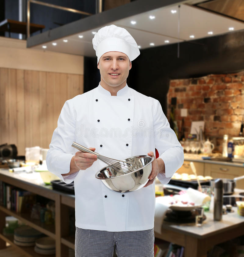 Happy Male Chef Cook Whipping Something With Whisk Stock