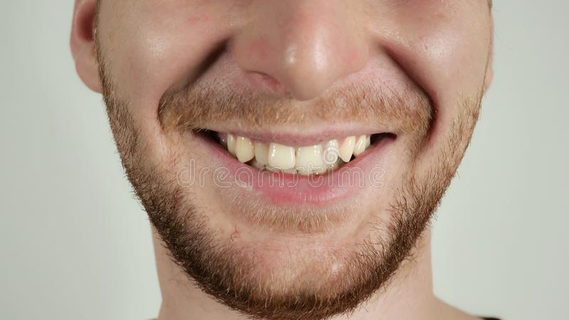 Happy male closeup lower part of the face royalty free stock photography