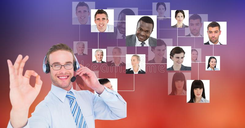Happy male customer care representative showing OK sign against flying portraits stock images
