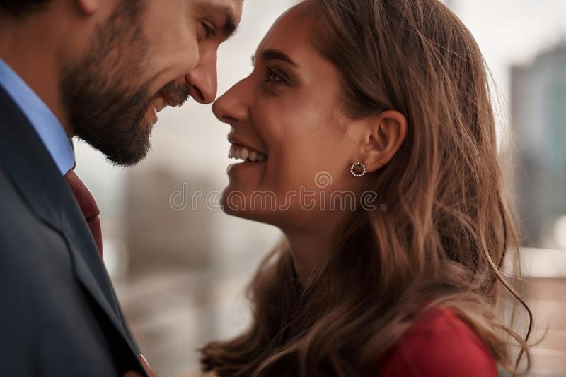 Happy male and female looking with love to each other. Concept of happy romantic meeting. Close up portrait of smiling beloved lady looking with love to her male royalty free stock photo