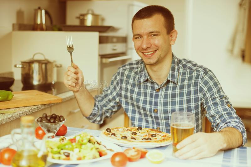 Happy male going to eat pizza. Ordinary happy male going to eat pizza royalty free stock photo