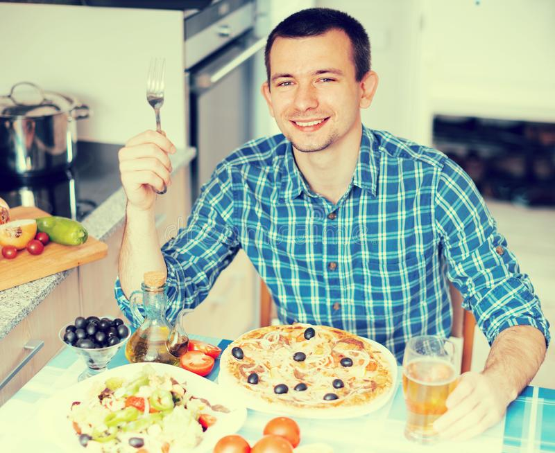Happy male going to eat pizza. Happy smiling male going to eat pizza stock images