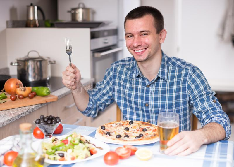 Happy male going to eat pizza. Smiling happy male going to eat pizza stock photography