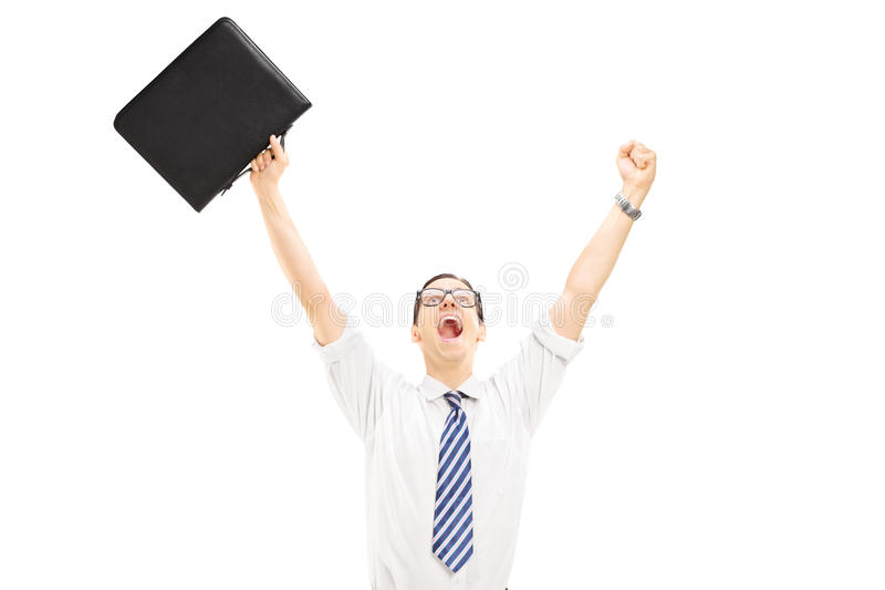 Download Happy Male Holding A Suitcase And Gesturing Happiness With Raise Stock Photo - Image: 38488466