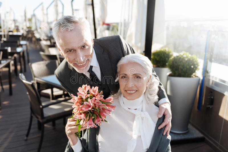 Happy male person embracing his girlfriend stock photos