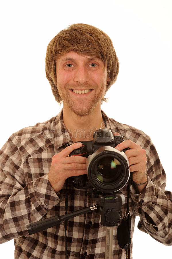 Happy male photographer. Half body portrait of happy young man in check shirt with photographic camera, isolated on white background royalty free stock photos