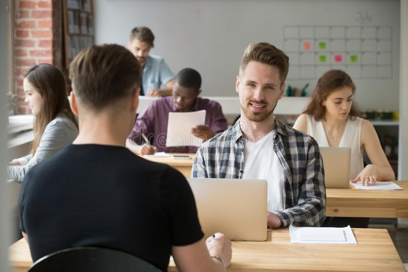 Male student happily looking at camera after exam stock photography