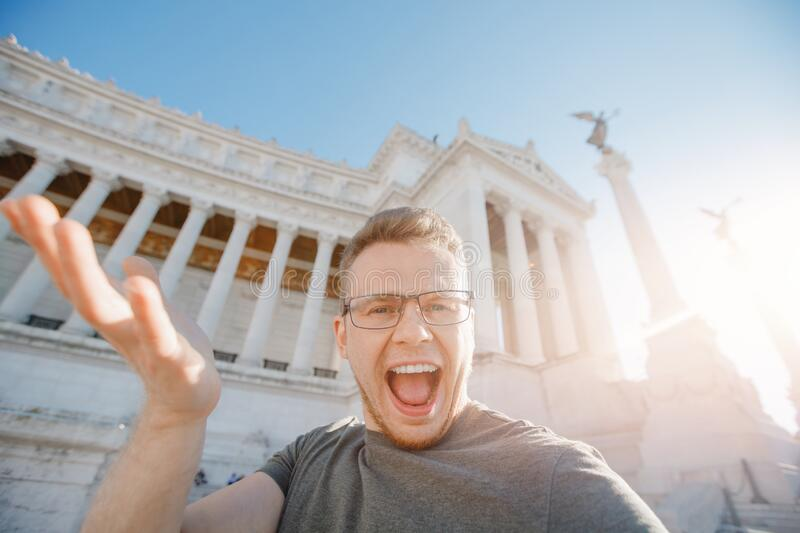 Happy male tourist taking selfie photo on background Venice Square in Rome Italy, blue sky. Travel summer concept stock photography