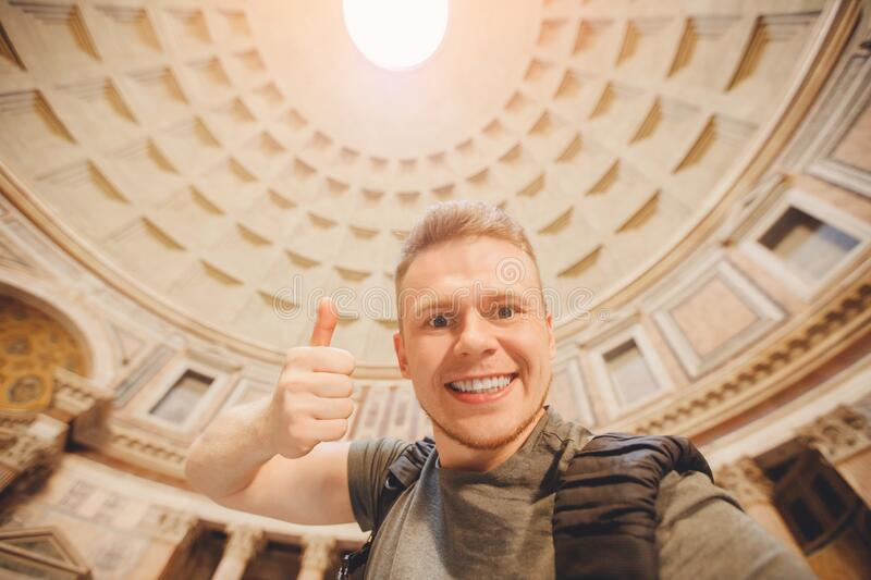 Happy male traveler taking selfie photo on background temple of gods Pantheon of Rome Italy. Concept travel royalty free stock photography