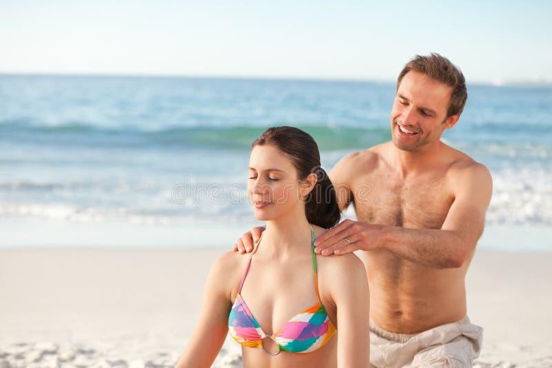 Happy Man Applying Sun Cream On His Girlfriend Stock Photos
