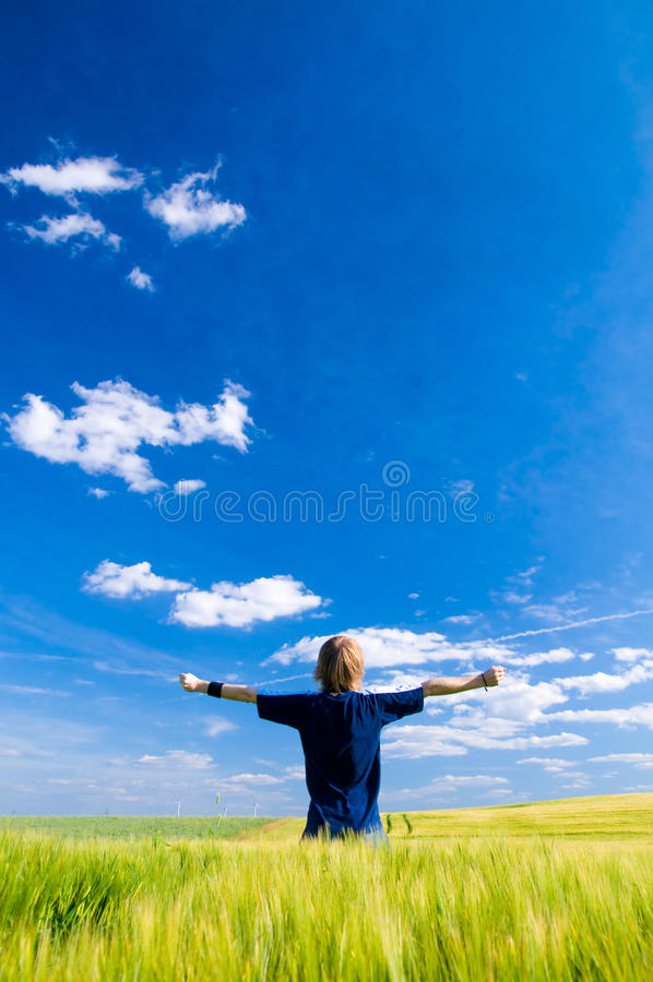 Happy man with arms up stock photo