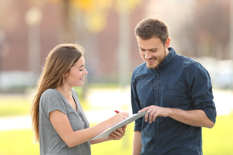 Happy man asking a survey in the street royalty free stock image