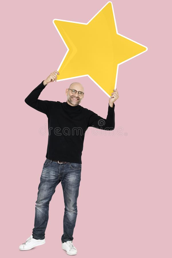 Happy man with a big star icon stock image