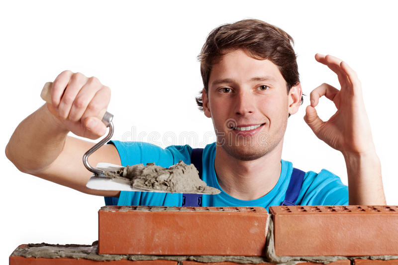 Happy man building a wall royalty free stock photography