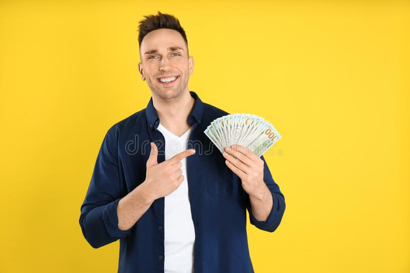 Happy man with cash money on background royalty free stock photo