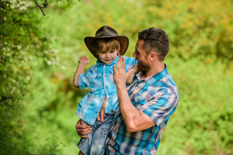 Happy man dad in forest. human and nature. family day. happy earth day. Eco farm. small boy child help father in farming. Happy men dad in forest. human and stock image