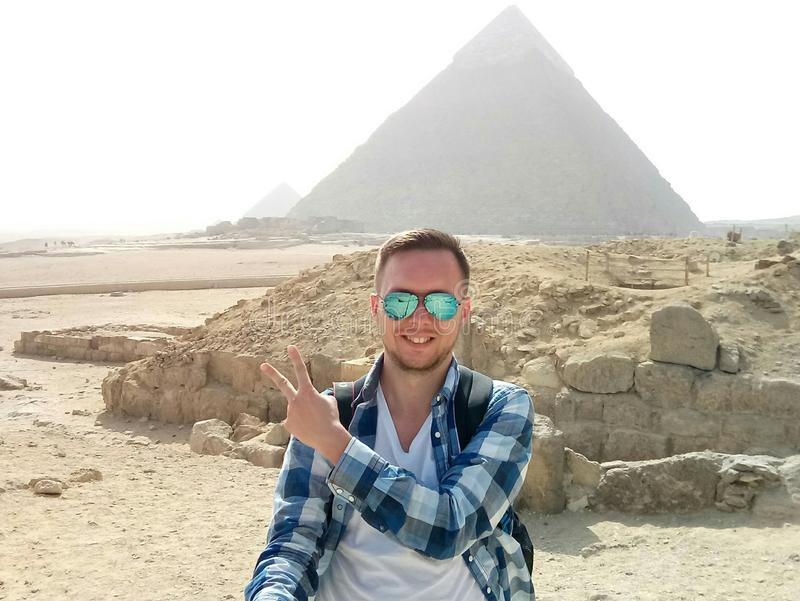 Happy man with the Egypt pyramids view royalty free stock photography