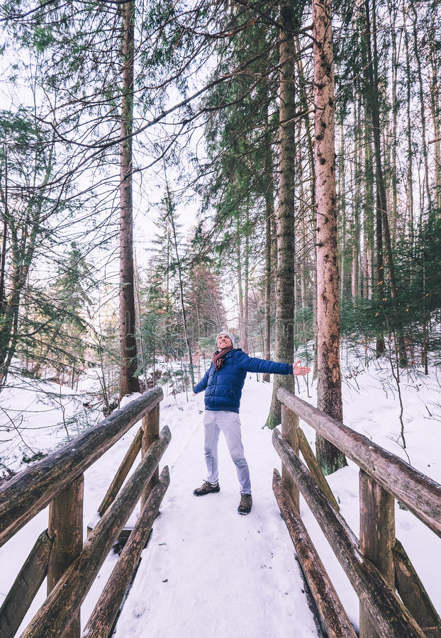 Happy man enjoy with winter walk in forest stock photos