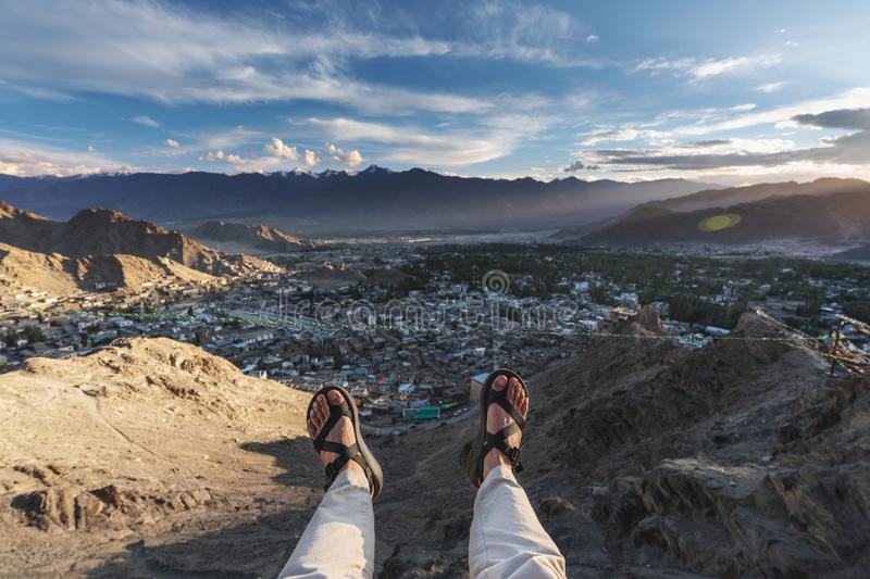 A happy man enjoying beautiful aerial landscape view point in Leh city, in Ladakh region, India. Travel lifestyle and happy holida royalty free stock photography