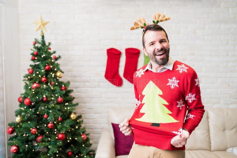 Happy Man Enjoying Christmas At Home stock photography