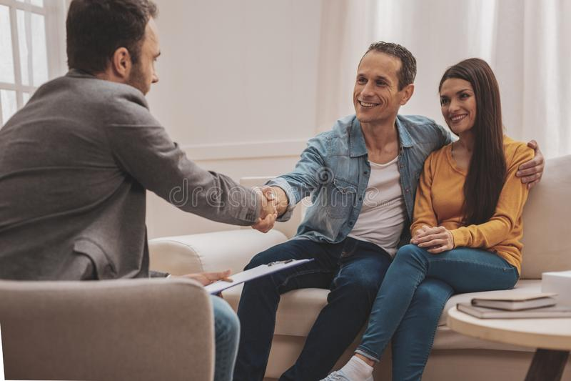 Happy man feeling satisfied after family relations session royalty free stock images